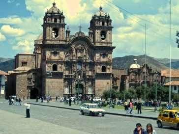 Cusco main square. The architecture here involves loud, impressive colonial buildings meshing into sleek and masterful Inca stonemasonry.